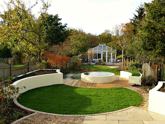 i like the circular lawn and how it meets the decking on the same level contemporary garden designlandscape