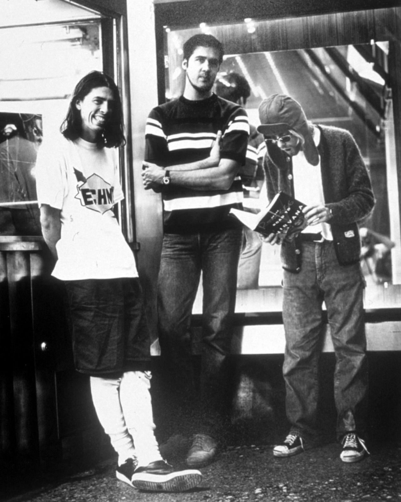 Dave = totally happy. Krist looks done. Kurt looks shocked by the contents of his magazine.