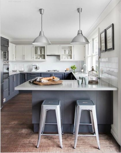 Want a bigger brighter kitchen get the two toned look designed w carla aston