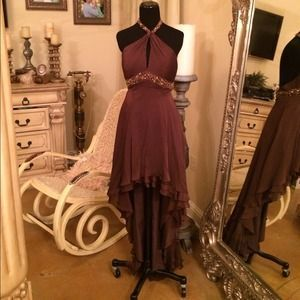 I just discovered this while shopping on Poshmark: Brown Halter neck Gown. Check it out!  Size: 4