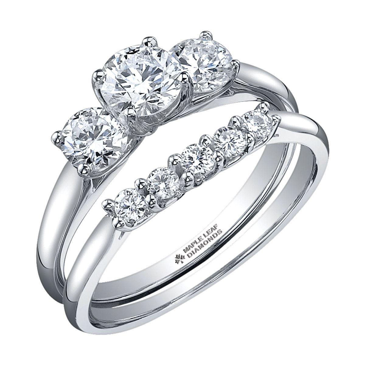 Classic Three Stone Diamond Engagement ring with round