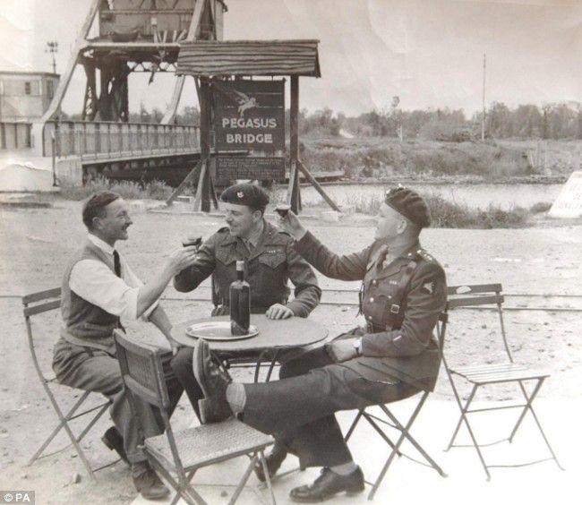 Georges Gondrée (left) with Major John Howard (centre) and Lieutenant David Wood, at Pegasus Bridge in 1946.