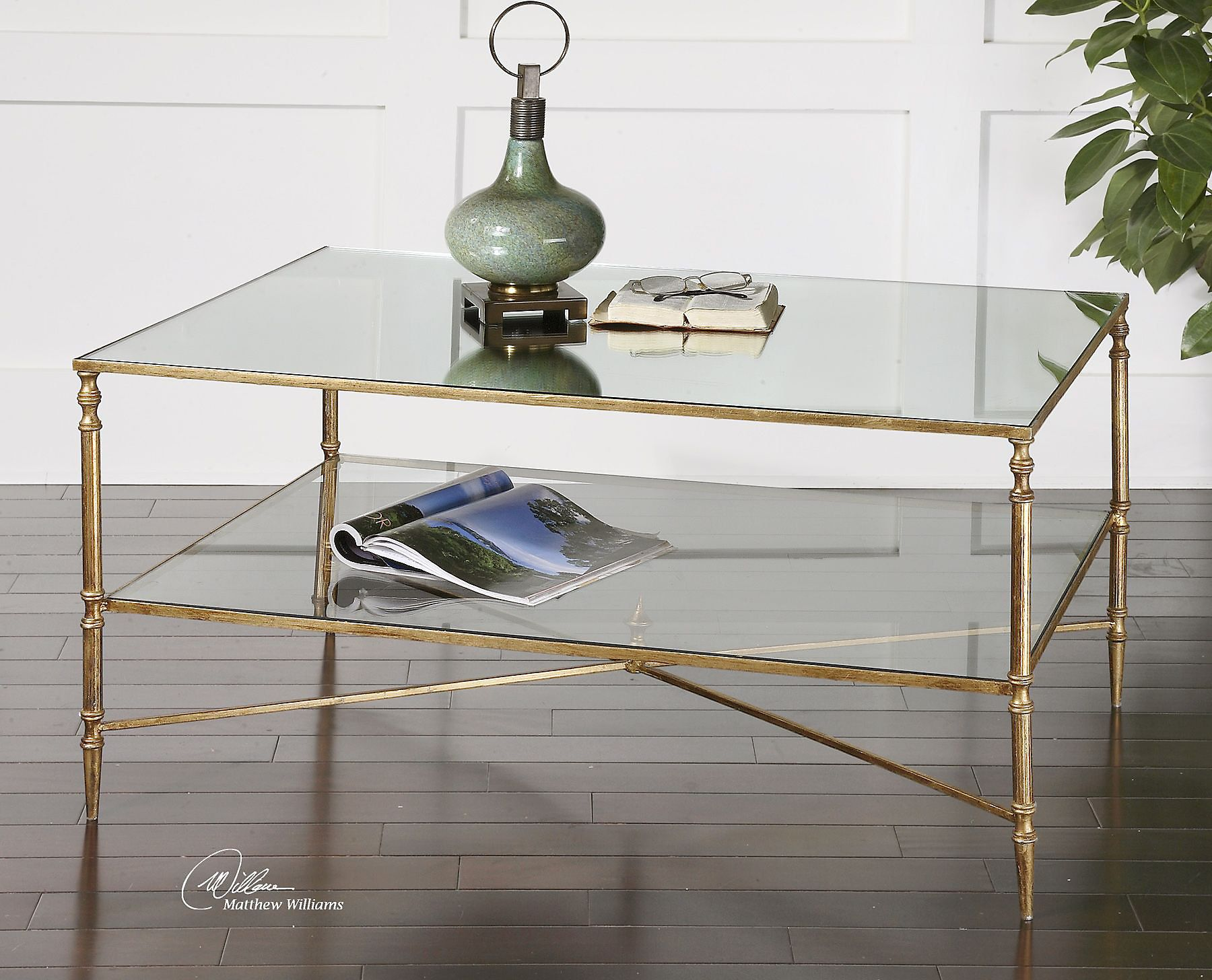 A Forged Iron Frame And Cross Stretchers Give This Sophisticated Coffee Table Streamlined Look