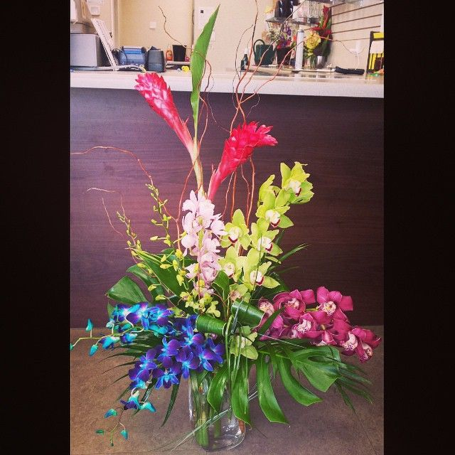 This is out of our Callingwood location again! A #vibrant #lush #tropical #arrangement with #beautiful #dendrobium and #cymbidium #orchids with #monstera and #ginger .