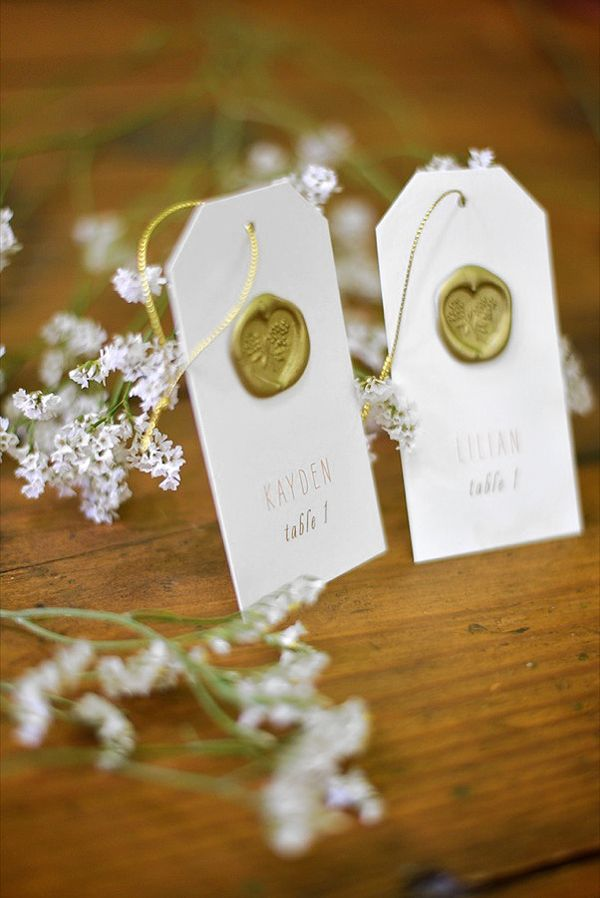 A gold seal card makes a pretty tag - http://www.weddingchicks.com/2013/10/15/brooklyn-garden-wedding/