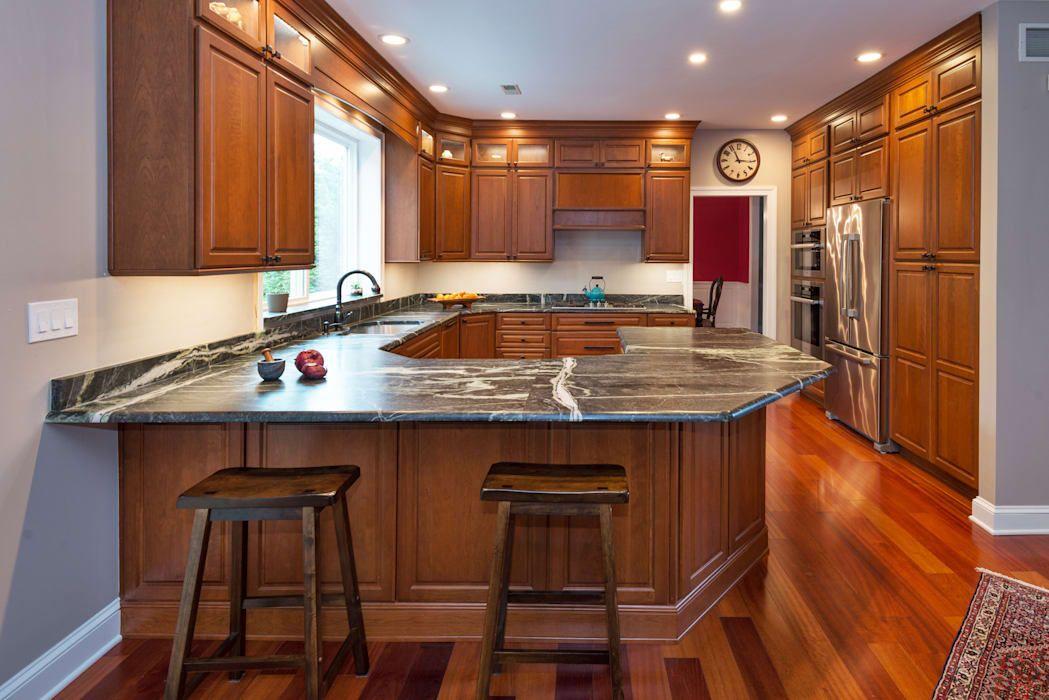 Bishop Medium Cherry Raised Panel Kitchen By Main Line Kitchen Design Classic Homify Kitchen Cabinets Brands Best Kitchen Cabinets Small White Kitchens