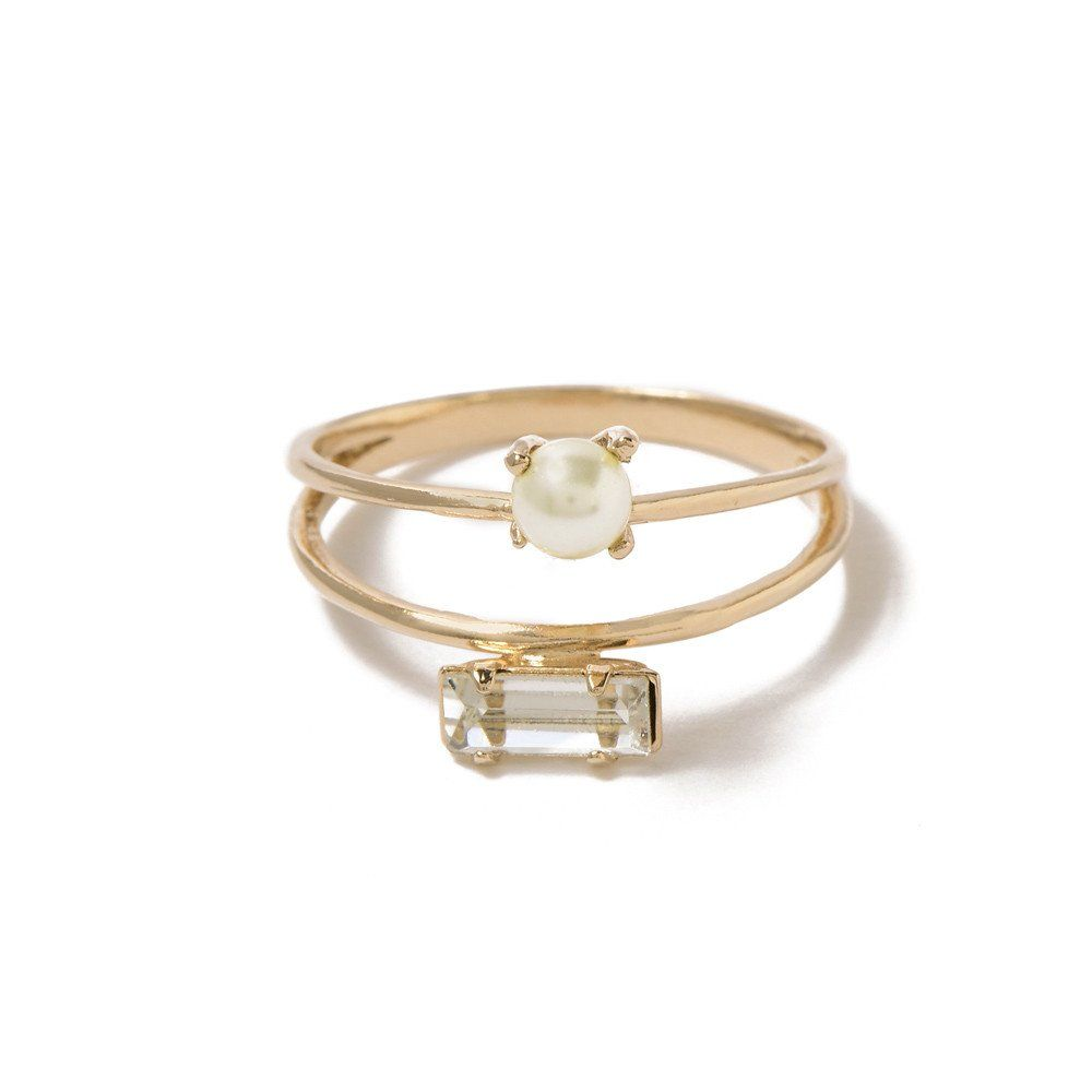 cb4e8b6ff Two thin bands featuring a delicate, prong-set cream pearl and our classic  Tiny Baguette Swarovski crystal. Elegant and interesting, one ring that  appears ...