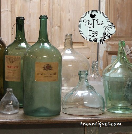A collection of old European bottles and cloches.