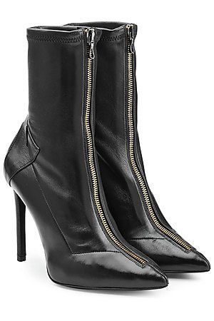 A sharp pointed toe and tough gold-tone zipper lends instant attitude to these glossy black boots from Roland Mouret #Stylebop