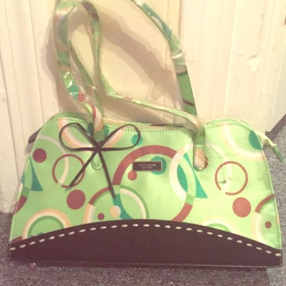 Kate Spade handbag Green, polka dot, still has some wrapping on it. Never used kate spade Bags Mini Bags