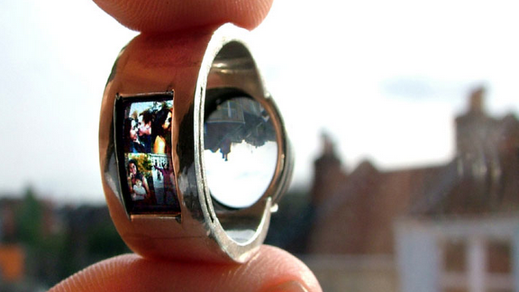 Romantic...custom made ring with mini slides that can be projected on a wall when light passes thru it