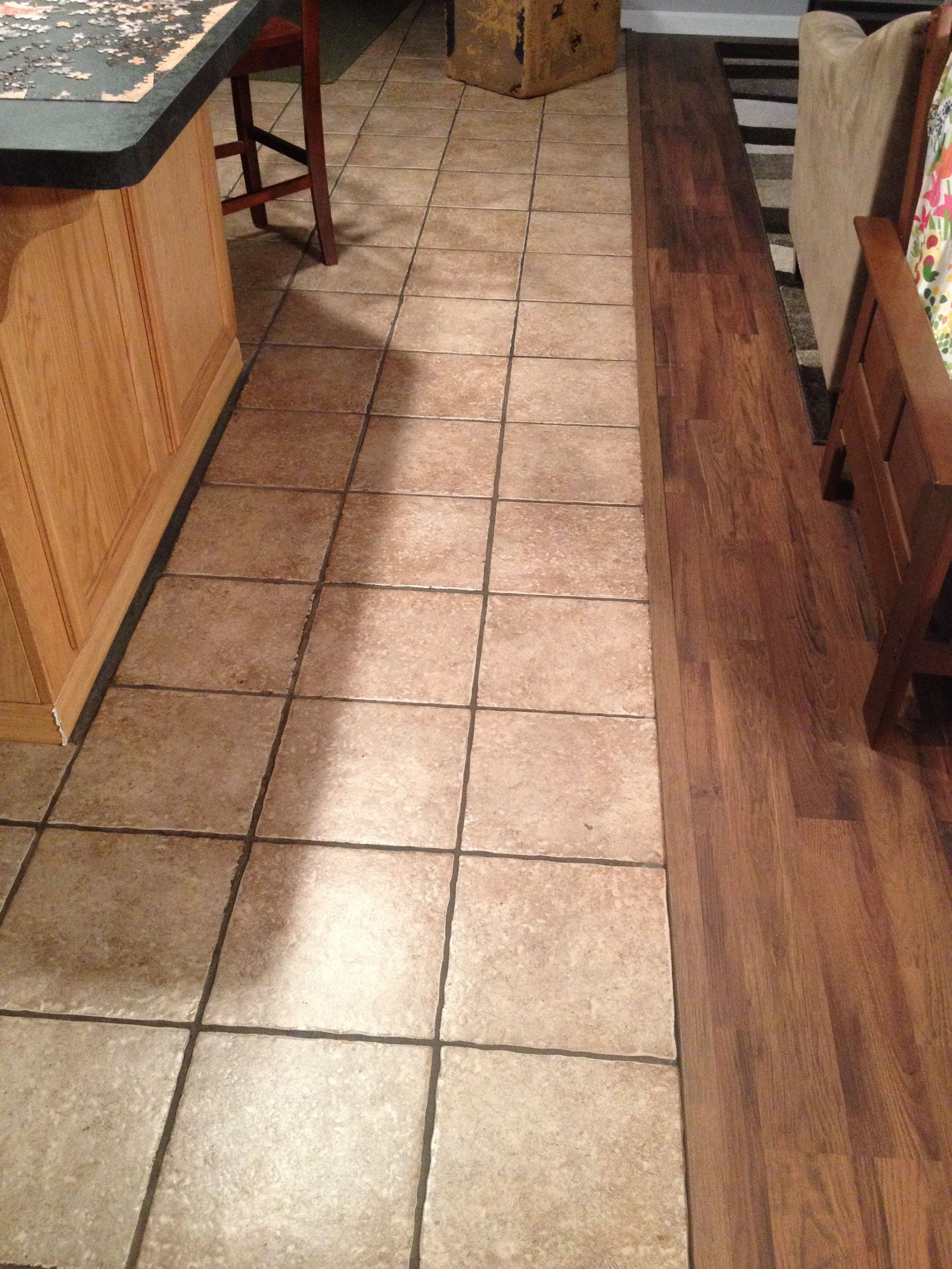 Shaw Floating Laminate Flooring Cabin Color With Matching Transition Piece To Tile