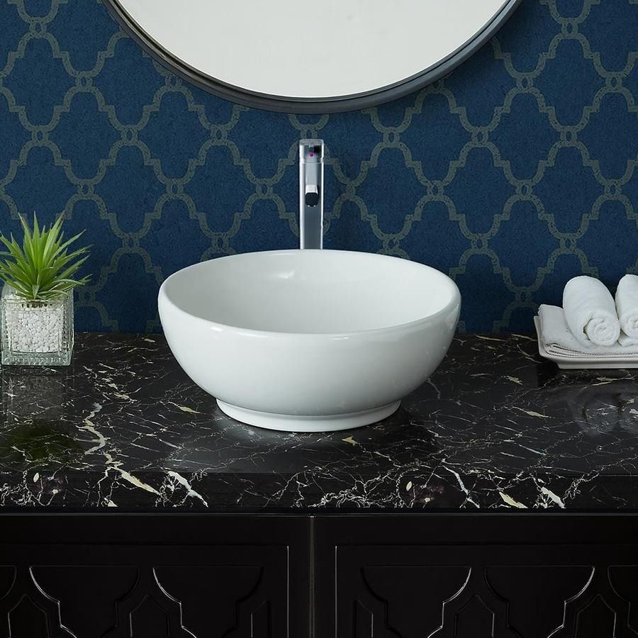 Sleek and contemporary, this oval vessel sink boasts a simple ...