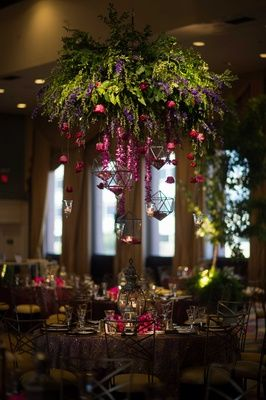 Unique Floral Chandelier Above Enchanted-Themed Table | Photography: Photography by Edmonson Weddings. Read More: http://www.insideweddings.com/weddings/catholic-hindu-ceremonies-reception-with-enchanted-forest-theme/833/