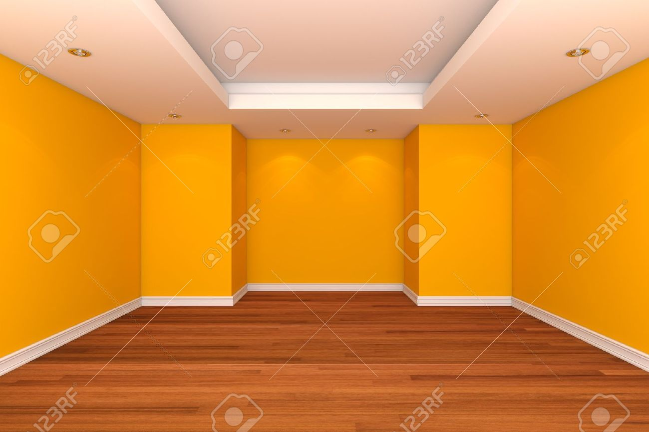 Sala vac a pared color amarillo con suelos de madera for Colores para paredes de interior