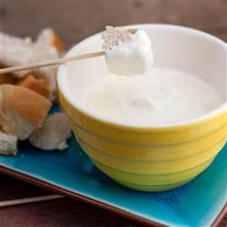 Parmesan Fondue Parmesan Fondue . 1/4 (8 oz) package Neufchatel cheese - 1/4 cup & 2 teaspoons milk - 3 tablespoons & 1-1/4 teaspoons grated Parmesan cheese - 1/8 teaspoon garlic salt - 1/4 small loaf French bread, cut into cubes. Stir Neufchatel cream cheese in milk in a saucepan over medium-low heat until melted, 2 to 3 minutes. Add Parmesan cheese and garlic salt. Cook and stir until the Parmesan melts, 2 to 3 minutes more. Serve with bread cubes and mushrooms.