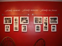 A Family Moments Photo Collage hanging on a red wall with a wall lettering above it.