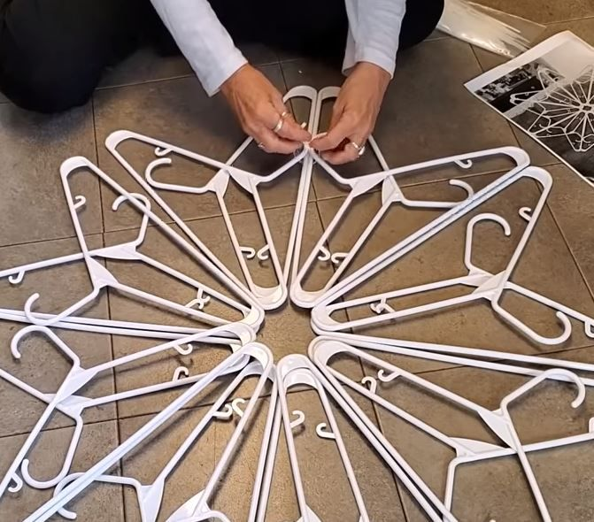 With 16 hangers woman makes beautiful snowflake decoration