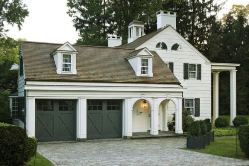 That is the single most beautifully designed garage I have ever seen. The detailing, the scale, the proportions … just … sigh
