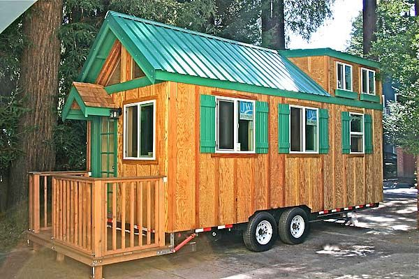 This tiny house is 8 ft 6 in wide by 20 ft long by 13 ft 5 in