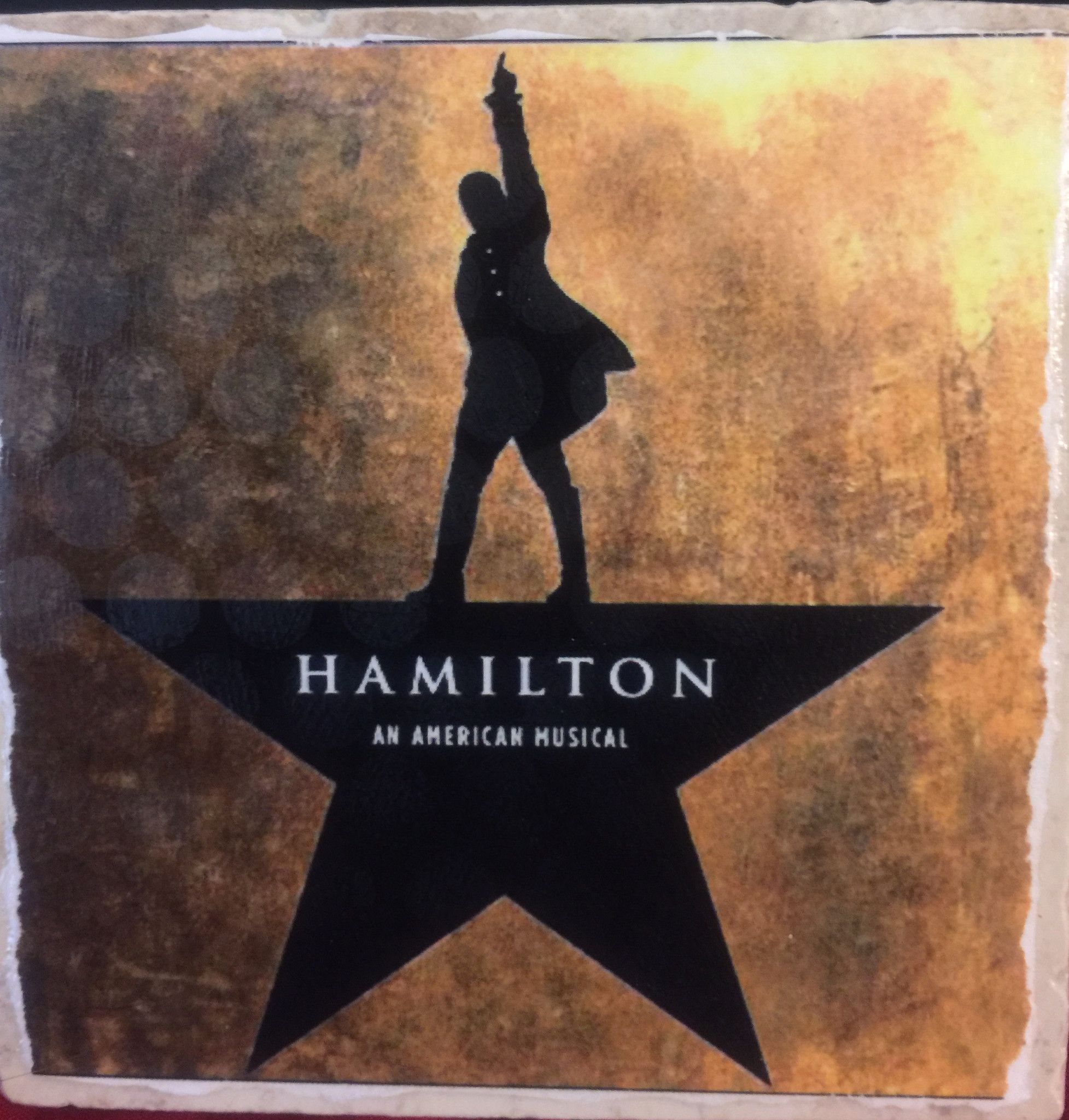 Choose from one of our already made tiles listed here or have your favorite show custom made just for you: Newsies, Kinky Boots, Hamilton, The Book of Mormon, Xanadu and The Wiz are available to compl