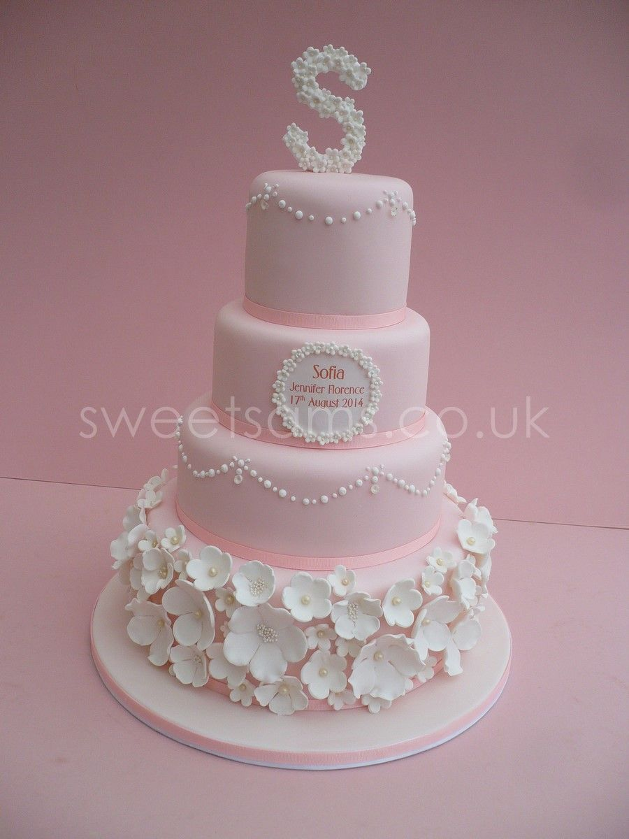 Baby girls christening cake, with flowers and piped dot ...