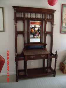 Antique Hall Tree, Large Tiled Table, Umbrella Stands, Mirror.