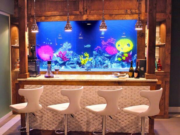 Salt Water Fish Tank Behind A Home Bar. So Cool!