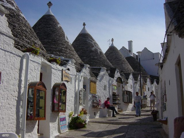 Alberobello Apulia Puglia - Alberobello is a small town and commune in the province of Bari, in Puglia, Italy. It has about 11,000 inhabitants and is famous for its unique trulli buildings with high conical roofs..