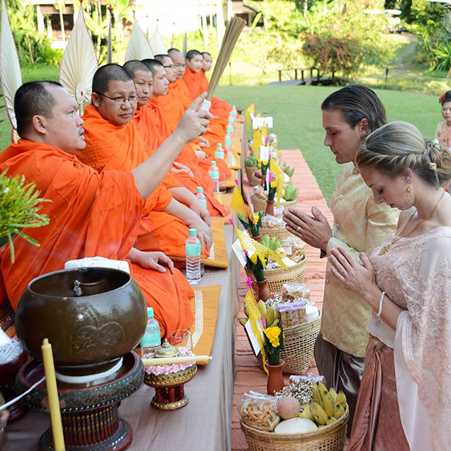 Couple Receiving Traditional Buddhist Blessing At Real
