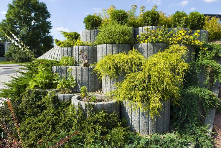 Beeteinfassung Beton pflanzsteine setzen bepflanzen rund gross grau beton optik