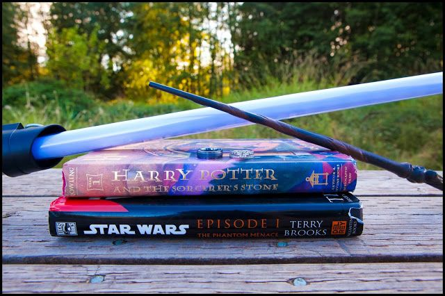 Carissa Holm Photography. Star Wars Vs. Harry Potter Wedding Ring Photo.