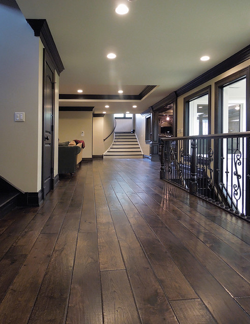 The triple hardwaxed Walnut flooring really shines in
