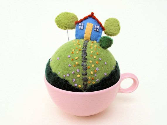 Tiny world felt pincushion.  You can move the trees which are on pins :)