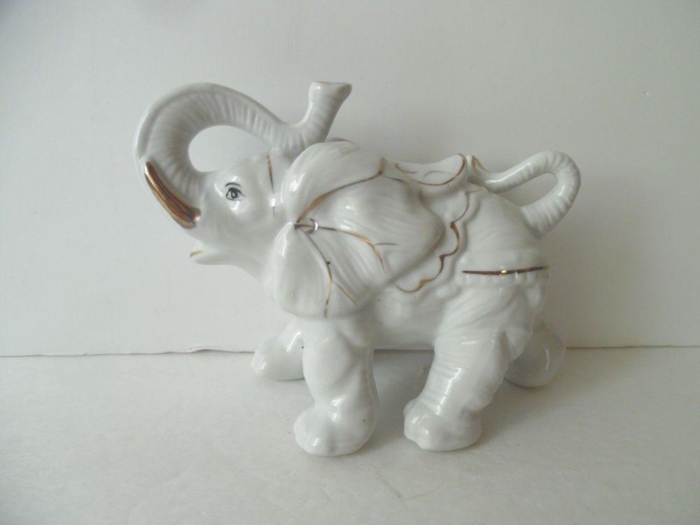 White Glazed Porcelain Elephant Figurine With Gold Trim
