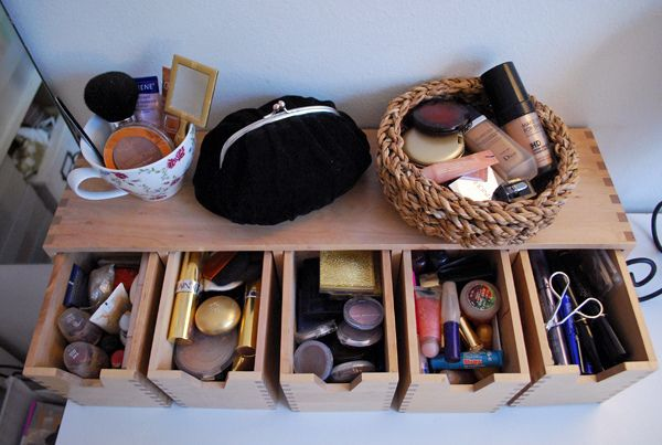Love the idea of a little, simple wooden drawer set to hold makeup.