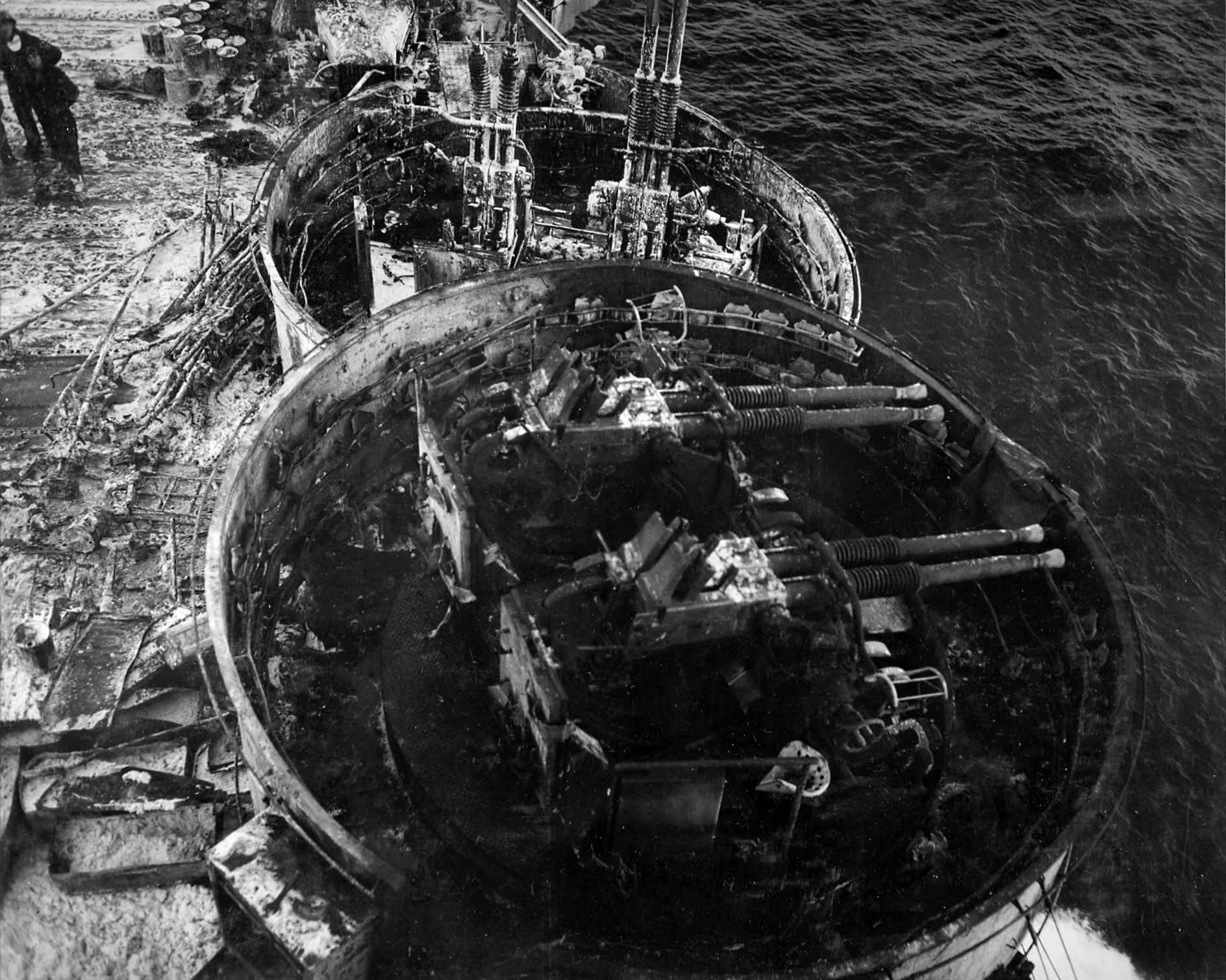 wrecked 40mm bofors batteries abroad the aircraft carrier uss enterprise following a kamikaze