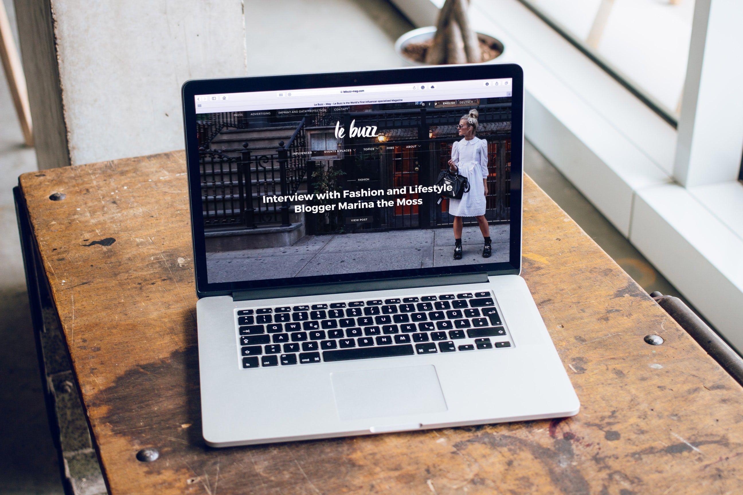 Macbook Pro On Brown Wooden Table Best Web Design Company Orlando Web Design Art Photography Marketing Web Design Company Best Web Design