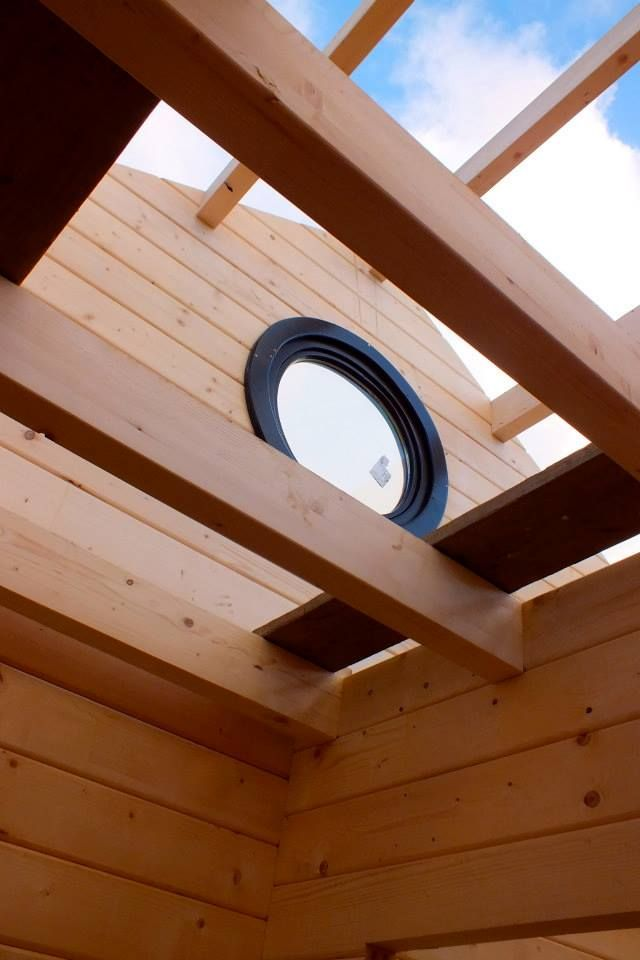 round window, log cabin, view to the sky. early days.
