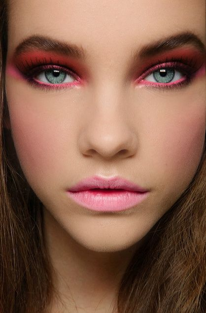 pinkish-red makeup. major statement