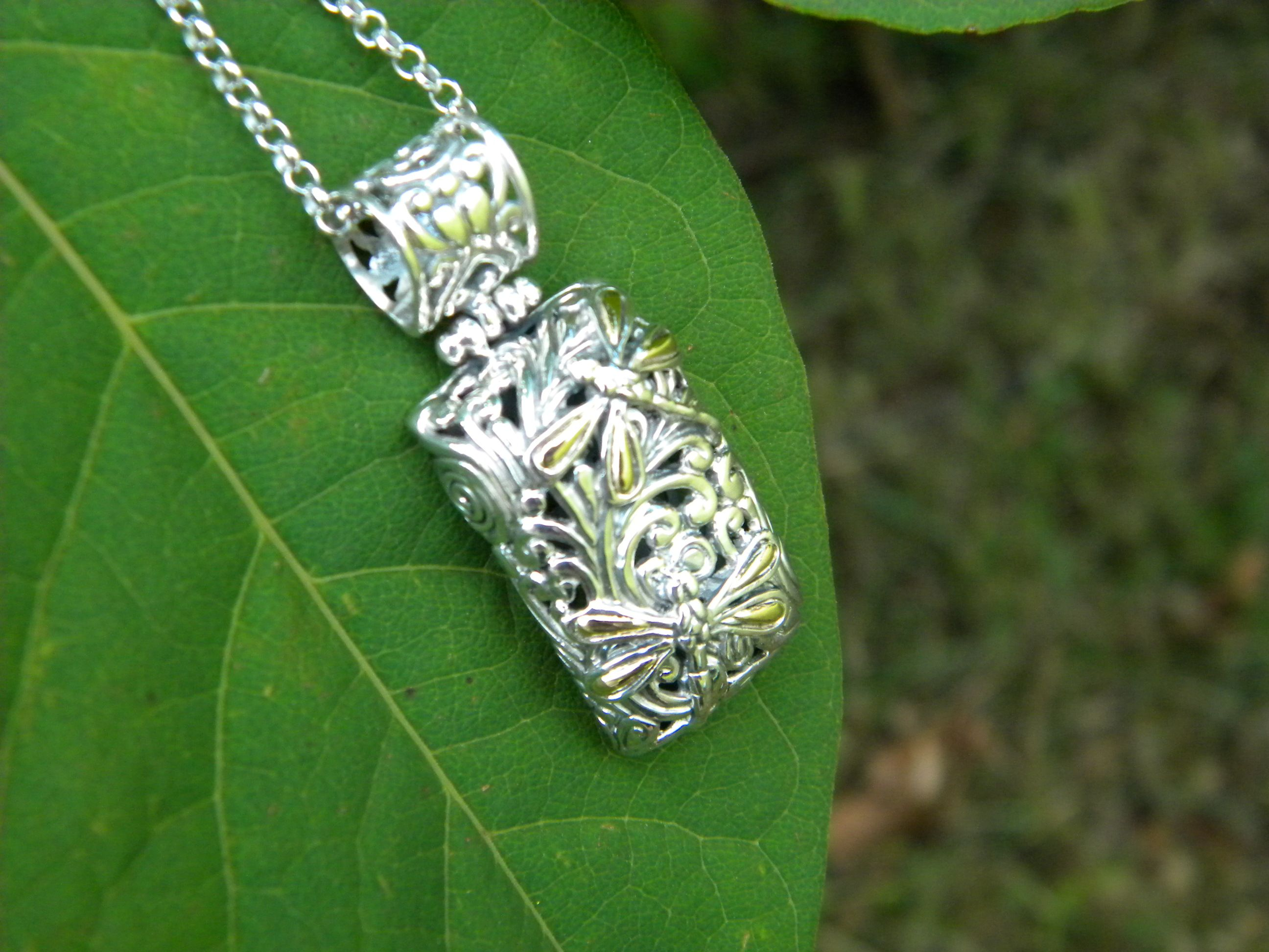Dragon Fly pendant by Phillip Gavriel. Available at Diana Jewelers of Liverpool NY