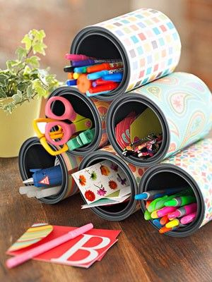 easy DIY organization project: cover old tin cans with pretty paper to create desk organizers