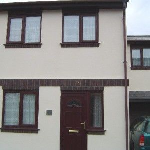 1980s semi front view render wall coating on a house in Ivybridge, Devon