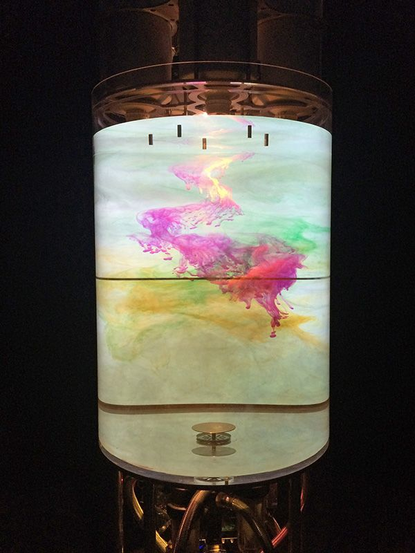 Colored inks are slowly poured into a clear water tank. Sculpture by Renaud Marchand at Palais de Tokyo Paris within Michel Houellebecq's summer 2016 show.