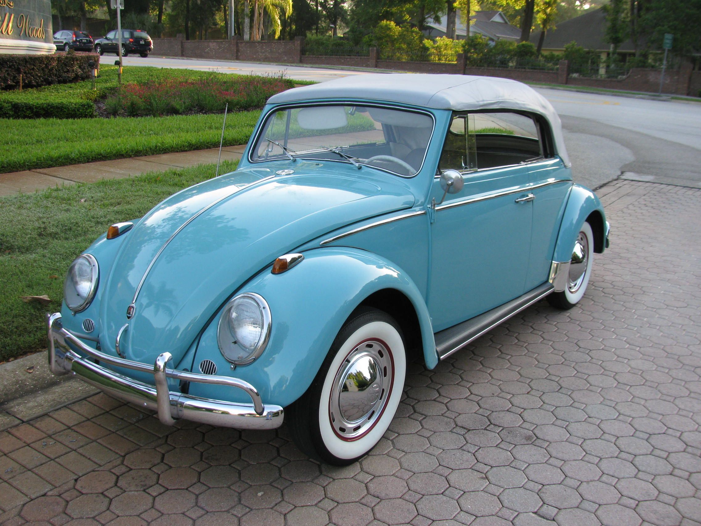 Vintage Powder Blue On White Vw Bug Convertible With Walls