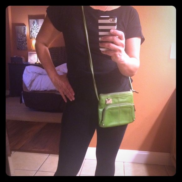 Avocado Green Tignanello Small Purse This avocado purse is such a fun color, and has a beautiful small cobble pattern in the grain of the leather. It has great inner compartment, and built in front pocket so no wallet is needed! Excellent condition! Measures 10x6.5 Tignanello Bags Mini Bags