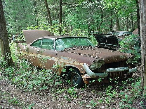 Abandoned '57 Plymouth. Sad, b...