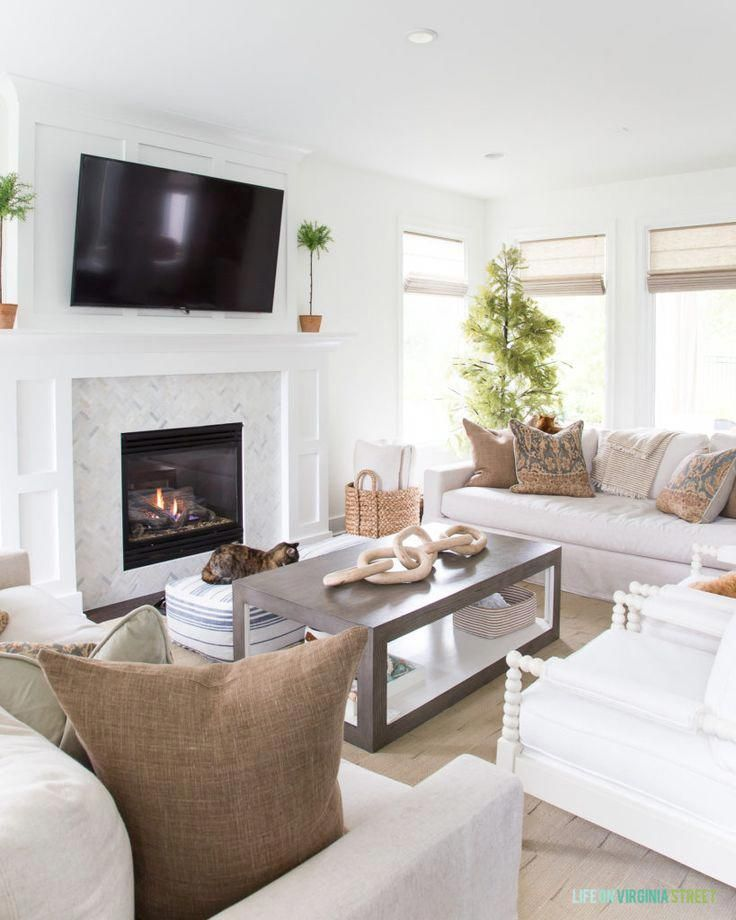 gorgeous white and bright living room with a cozy white