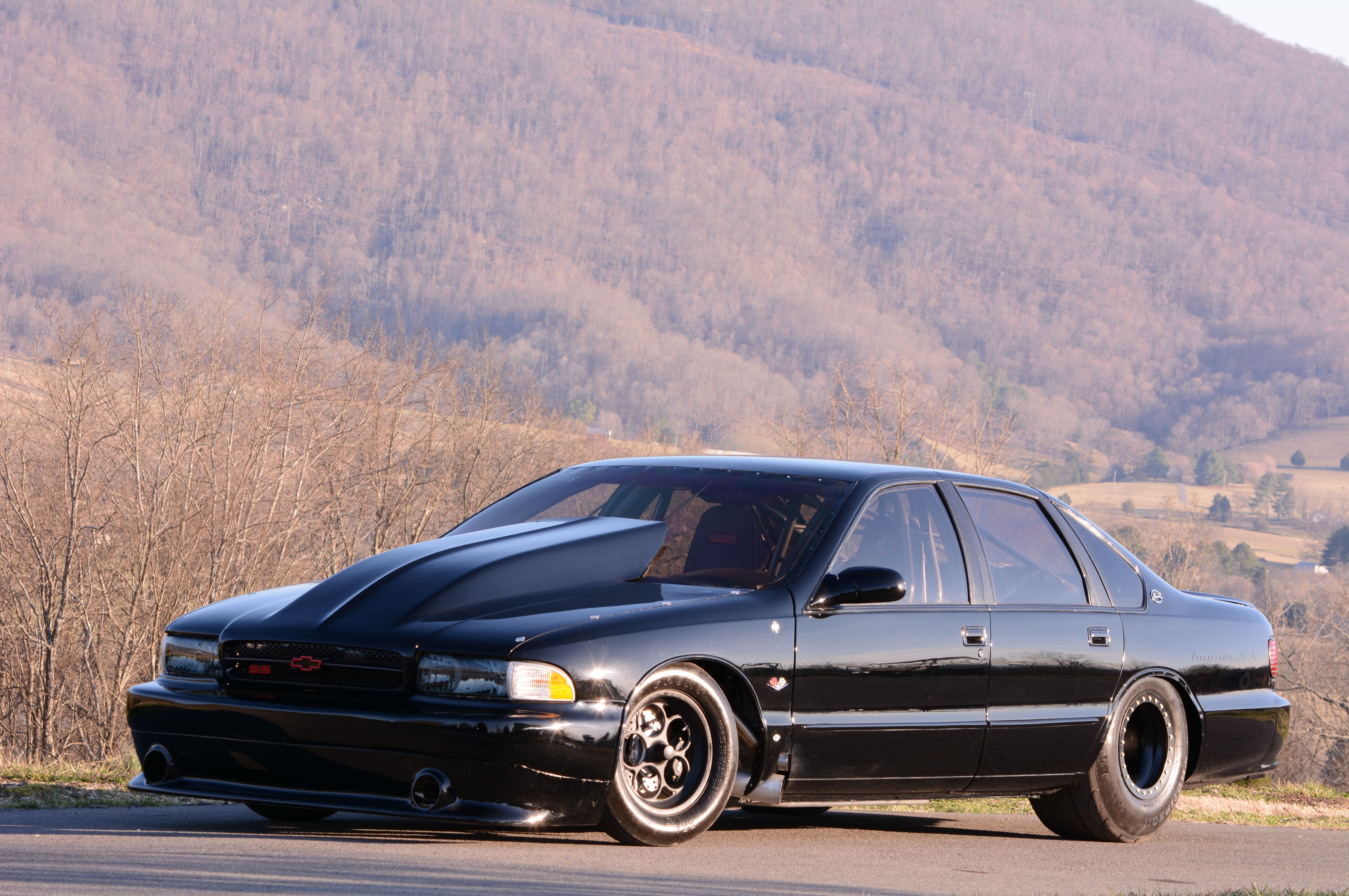 Rick wetherbees bad in black 1996 chevrolet impala ss is an outlaw rick wetherbees bad in black 1996 chevrolet impala ss is an outlaw drag radial fandeluxe Images