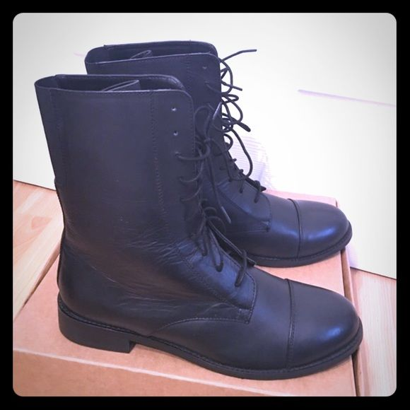 Black leather combat boots Brand new with tag and box. I think this was a display pair so the right boot has been tried on and it shows in the leather (first pic) I know that will happen when you start wearing them but just wanted to point it out. 100% genuine leather and rubber sole. There is also a stretchy elastic band in the back of the boots. I am open to reasonable offers! ✨ Urban Outfitters Shoes Combat & Moto Boots